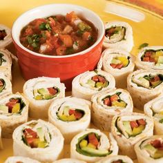 Mexican Sushi Bites. Cream Cheese, Avocado, and crisp Bell Pepper are rolled in a tortilla and sliced for a sushi-like presentation.