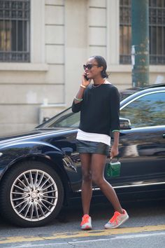 This is simple but chic: Chanel trainers, black leather mini skirt, white tshirt and fluffy sweater also in black... perfect!