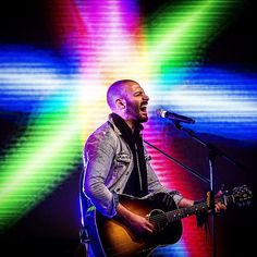 New York performing artist Ryan Star plays for fans at Pruis Hall after the winner of the reality show The Song was chosen Saturday. #muncie #thesong #music #color #play #famous #celebrity #judge #indiana #sing #final #tv #reality - Jordan Kartholl