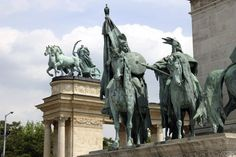 These are statues of some of the seven tribes of Hungary.  Heroes Square, Budapest, Hungary