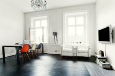 black floor, white walls, orange chair