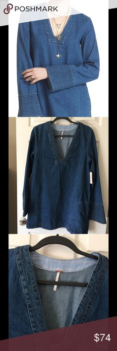 "NWT Denim daydream  tunic M This cute long sleeve Free People denim dress or top. Size M $128 Trapunto stitching at the neckline and cuffs lends rustic contrast to a relaxed-fit tunic cut from soft denim and finished with cool front pockets. - V-neck - Long sleeves - Front pockets - Slips on over head - Approx. 31.5"" length (size Medium) - Imported Free People Tops Tunics"