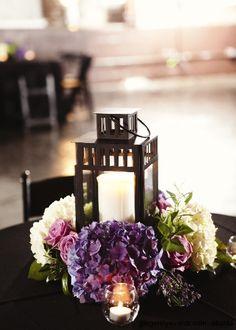 Very pretty!  Purple hydrangeas & lanterns.