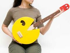 Whether you're chomping on a power pellet, running from googly-eyed ghosts or devouring random floating fruit, there's no better way of celebrating your love for Pac Man than this custom made Pac Man ukulele. With this custom made baritone ukulele shaped in the form of Mr. Pac man on the body and Red Ghost shaped…