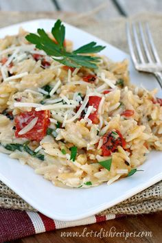 Orzo with a creamy three cheese sauce, fire roasted tomatoes and spinach.