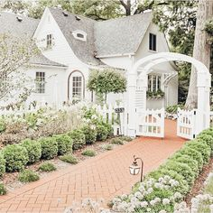 Cute white cottage with archway and gate. Cottage Shabby Chic, White Cottage, Cozy Cottage, Cottage Homes, Cottage Style, Mary Engelbreit, Future House, Storybook Cottage, Storybook Homes