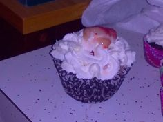 Cocoa Cayeene Cupcakes filled with fresh strawberries, topped with homemade whipped cream, and an extra strawberry chunk on top.