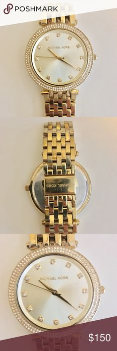 Michael Kors Darci Watch Michael Kors gold tone, stainless steel Darci watch, 39 mm. Swarovski crystals around the band and in place of the numbers, which was an extra feature from the original darci watch. No flaws, brand new battery put in in the last six months. Michael Kors Accessories Watches