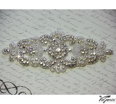 Wedding sash, Bridal belt , Bridal sash - satin ribbon with crystal,  pearl and rhinestone beaded applique. $59.99, via Etsy...Something very similar for my wedding dress :)