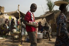 Siegfried Modola/Reuters DISPLACED: A street vendor walked in a camp for internally displaced persons at the airport in Bangui, Central African Republic, Friday. Almost a million people, a quarter of the population, have been displaced by fighting since the Seleka rebel group seized power in March.