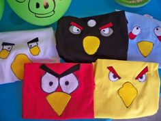 These Angry Birds shirts (from The Crafty Woman) would be pretty easy to make, but do I dare encourage the obsession?