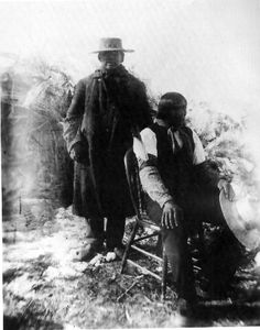Wovoka (seated), the Paiute medicine man and mystic, whose visions of a world without white men, renewed by the spirits of the dead, inspired the late 1880's Ghost Dance movement among western tribes, leading to the Massacre at Wounded Knee.