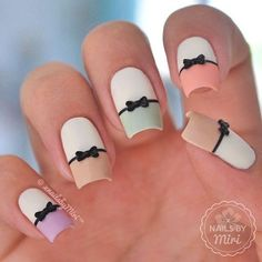 Cute pastel colored bow French tips. Give a new look to your French tips by adding thing bow embellishments on top.