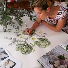 A picture of me painting a new fabric design which I am so obsessed with, can't…