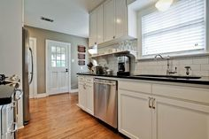 I clearly have a type... white cabinets, white subway tile & warm wood floors.