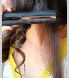 A lovely way to curl your hair with a straightener.
