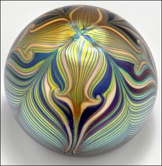 Orient & Flume Golden Feather Studio Art Nouveau glass paperweight, seen on eBay.~T~ I have one very much like this that I bought when I was going to Chico State. Orient and Flume is located in Chico Ca. Their glass is lovely.