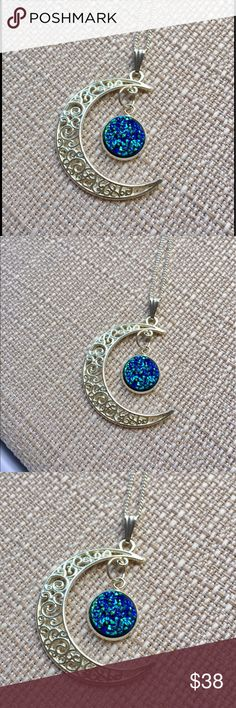 """Crescent Half Moon Necklace - Ocean Blue Druzy This beautiful Crescent Half Moon Necklace is a perfect addition to your summer wardrobe. Gorgeous in Victorian silver scroll detail featuring a shimmering Druzy gemstone in the iridescent colors of blue, teal, and green. The pendant measures 1.5"""" L x 1.25"""" W. Nickel and lead free!  Necklace chain is 18 inches. If you prefer a different chain length, please let me know. Bundle and save 15% on 3+ items. Couture By Lolita Jewelry Necklaces"""