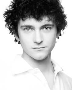 George Blagden - plays Grantaire in Les Mis. Who knew that behind that mop of hair he was such a looker :P