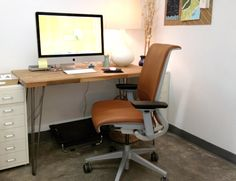 D.I.Y Desk made from IKEA Countertop and cool metal legs.
