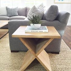 gray linen couch, natural wood side table and fiber rug