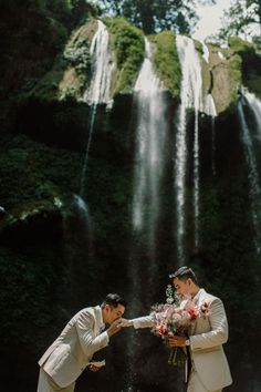 Talk about a backdrop! See more from this magical elopement on the blog. | Image by Kien's Collection Vietnam Destinations, Planning A Small Wedding, Destination Wedding Planner, Wedding Story, Photography And Videography, Wedding Venues, Waterfall, Romantic, Elopement Ideas