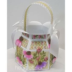 Courtyard Gifts Altered Art Gift Basket - has been created with the Backyard Blossoms Collection from Heartfelt Creations and is a wonderful gift packaging idea! Perfect for the summer season, this delightful altered art papercraft project will work beautifully for Mother's Day, summer birthdays, or even summer weddings! Find instructions here! #HeartfeltCreations #papercraft #giftbag #diycrafts #giftwrapping #giftbasket #diy #makeandcreate #cardmaking #papercrafts #summer #coneflower