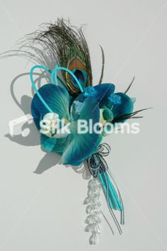 Jade Green and Galaxy Blue Orchid and Peacock Feather Corsage