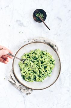 A delicious, quick, easy Whole30 paleo meal. Creamy veggie zucchini noodles with creamy avocado pesto! Loaded with garlic, lemon, & basil!