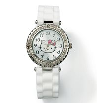 "Sweet Shine Hello Kitty® Watch. Ladies silvertone Hello Kitty silicone strap watch with a rhinestone bezel. Silicone strap, 9"" L x 3/4"" W. Comes in a black Avon jewelry box with white Hello Kitty graphics sleeve. Shop my eStore 24/7. youravon.com/taylorenterprises"