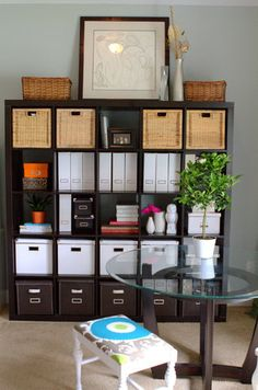 A College Park home office that keeps clutter to a minimum with an Ikea Expedit bookshelf filled with organizing boxes and magazine files fr...