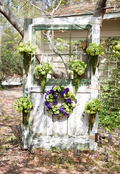 An salvaged door used as a place to display planters. - My Garden Decor List Garden Whimsy, Garden Junk, Garden Yard Ideas, Garden Doors, Garden Fencing, Garden Projects, Old Door Decor, Vintage Doors, Rustic Gardens
