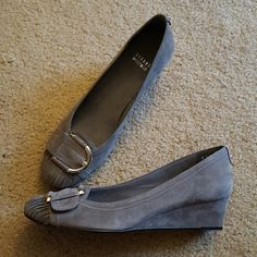 ☆HP☆ NEW Stuart weitzman grey suede wedges Super soft grey suede wedges. Silver buckle accent with ruching at the toe. Never worn-only tried on! No box. Smoke free home. NO TRADES- REASONABLE OFFERS WELCOME Stuart Weitzman Shoes