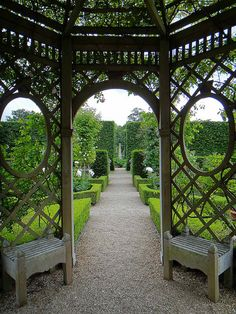 Super Gazebo!! Love the small benches on either side of entry way!! Seend Manor Rose Garden (photo by Paul). 18th century Seend Manor is located in Wiltshire, UK