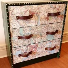 A good way to incorporate maps in the room. Transfer a map print onto wooden furniture (side table and maybe the inside back of the wardrobe) and add some vertical leather pulls