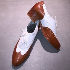 """Golf style wing- tipped women shoes. All leather top and sole golf style wing- tipped women's shoes.  Size 6-1/2 (more like a 6...runs small).  Heel Height:  1-5/8"""".  color is Rust and White. In perfect like- new condition...worn 2x. Shoes Flats & Loafers"""