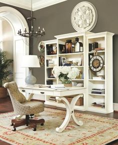 Traditional Home Office with Ballard Designs Elle Tufted Desk Chair, Arch doorway, High ceiling, Chandelier, Hardwood floors