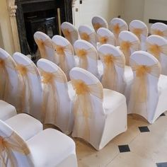 We finished this aisle decor with the traditional white spandex chair covers & champagne sashes! Beautiful wedding decor in a beautiful venue! White Chair Covers, Spandex Chair Covers, White Spandex, Pew Ends, Wedding Decor, Our Wedding, Sash, It Is Finished, Champagne