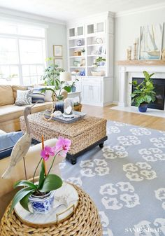 Coastal Design - Family Room - Escape to the sea with this summer blues coastal family room tour! Get easy coastal decorating ideas to transform your home into a chic coastal retreat. Complete with product source links!