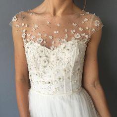 Christos wedding dress with floral appliqués  from Emma & Grace Bridal Studio || See more at emmaandgracebridal.com