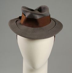 Interesting perching hat by Selbine. Looks like it was first blocked and then lightly crushed and molded. The outer brim appears to have been cut off and then stitched back on.
