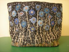 "Pictured above: ""Cornflowers"" Designed by: Jennifer Manuel Hooked by: Bev Baker"