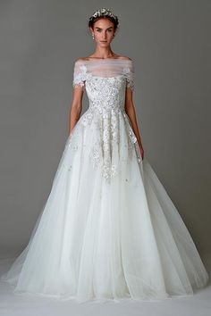 Wedding gown by Marchesa.Check out more gorgeous dresses in our Marchesa gown gallery ►