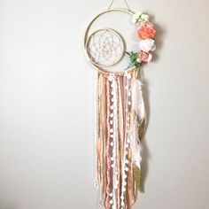 This dreamcatcher is by far one of the most beautiful Ive ever created, in my personal opinion!! The base is actually double layered, the cream twine web is hand woven in the small (6 inch) bare wood inner hoop, & that hoop is secured with cream twine to
