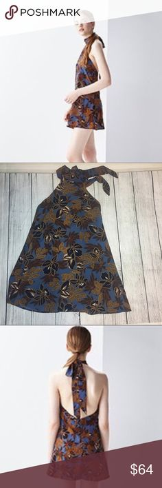 """🆕Gorgeous abstract print tunic ❤ Absolutely gorgeous abstract print tunic w/open back. Fully lined and has a gorgeous choked like tie up neck as shown in pictures. This silhouette piece is absolutely stunning and perfect for a night out. Has a beautiful flower print throughout. Made out of 100% ppl materials. MEASUREMENTS: SMALL- length :28"""" - bust 15"""" - MEDIUM: length 29"""" - bust 16"""" 💙 Dorimas Closet Tops Tunics"""