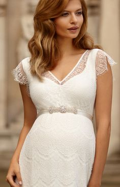 Our graceful floor-length lace maternity gown is magical.