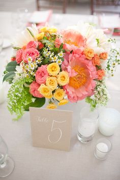 Bright, peppy #centerpiece florals + #tablenumber | Photography: anniemcelwain.com | Planning: greenribbonpartie... | Floral Design: brownpaperdesign.com