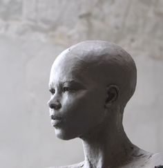 CLAY HEAD OF LIFESIZE NUDE SCULPTURE 2M HIGH FOR BRONZE:  don't know artist!