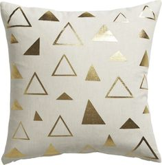 golden triangle.  Organic style goes glam.  Gold screenprinted triangles pop metallic in spontaneous pattern against natural linen.  Do the math: CB2 low prices include a pillow insert in your choice of plush feather or lofty down alternative (a rare thing indeed).