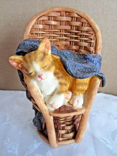 "Orange Tabby Kitten sleeping in chair resin figurine  4"" tall"